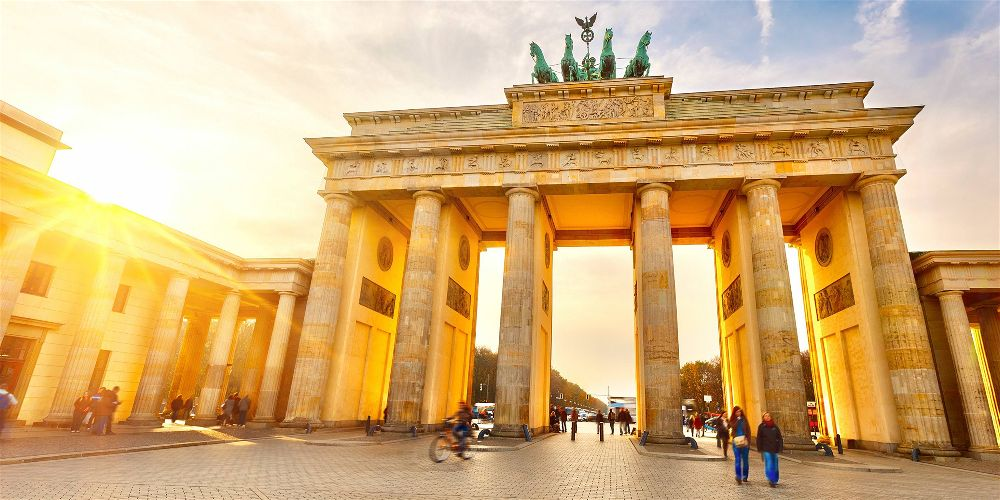 Sun rays shining on Brandenburg Gate in Berlin, Germany